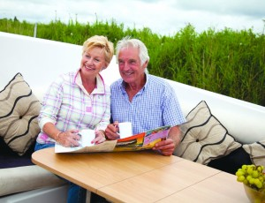 couple aboard a norfolk broads cruiser