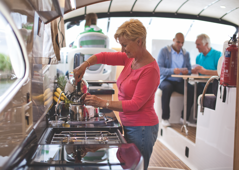 woman cooking on the broads